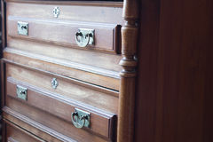 Vintage chest of drawers at an old home. Front view of a vintage chest of drawers, an old piece of family furniture Stock Image