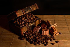 Vintage chest filled with coffee beans and candies Stock Photography