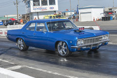 Vintage chevrolet car. Picture of blue vintage Chevrolet drag car in preparation on the track during the john scotti all out 17-19 june 2016 Stock Images
