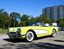 Vintage Chevrolet Corvette, Boston Commons Car Show. Vintage yellow Chevrolet Corvette being driven at the 2012 Boston Commons Car show in Boston, MA royalty free stock photo