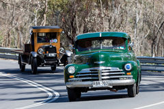 Vintage Chevrolet truck driving on country road. Adelaide, Australia - September 25, 2016: Vintage Chevrolet truck driving on country roads near the town of Royalty Free Stock Images