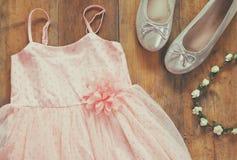 Vintage chiffon girl's dress, floral tiara next to ballet shoes Royalty Free Stock Photos