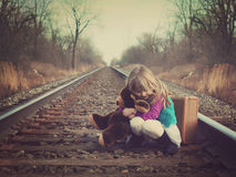Vintage Child Huggin Teddy Bear on Train Tracks Royalty Free Stock Photos