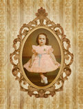Vintage Child Portrait. 50s Vintage style portrait with old frame and background decoration Royalty Free Stock Image