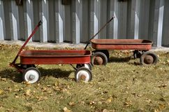 Vintage children red wagons Stock Photography