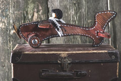 Vintage children's toy wooden airplane. Stock Photo
