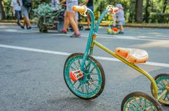 Vintage children`s tricycle second half of XX century stock image