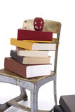 Vintage Childs School Chair and Books Stock Images