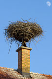 Vintage chimney and a storks nest Stock Photography