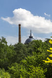 Vintage chimney and water tank behinde a forest Royalty Free Stock Photography