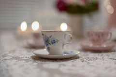 Vintage china tea cup. On a lace tablecloth Royalty Free Stock Photography