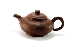 Vintage chinese brown teapot on white background Stock Photos
