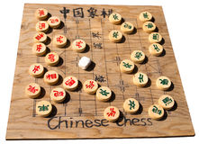 Vintage Chinese chessboard. Isolated old wooden Chinese chessboard and pieces Royalty Free Stock Photography