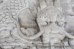 Vintage Chinese stone dragon statue Royalty Free Stock Photo