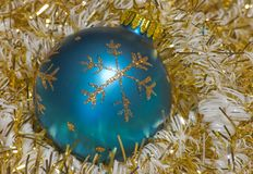 Vintage Christmas. Ornament surrounded by garland Royalty Free Stock Photos