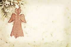 Vintage Christmas angel on snow background. Vintage wooden Christmas angel decoration on snow background Stock Image