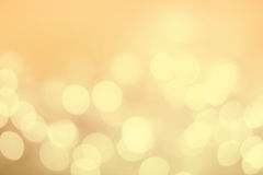 Vintage Christmas background with bokeh lights. Golden Defocused Royalty Free Stock Images