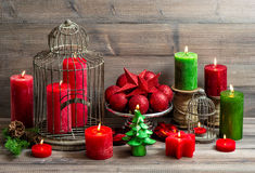 Vintage christmas background with burning candles and red bauble Royalty Free Stock Photography