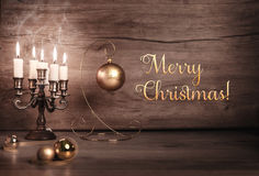 Vintage Christmas background with candles and Christmas baubles Royalty Free Stock Image