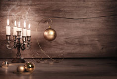 Vintage Christmas background with candles and Christmas baubles Royalty Free Stock Photography