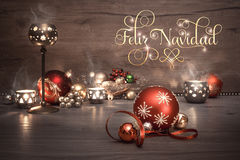 Vintage Christmas background with candles and decorations, text. Vintage Christmas background with candles and Christmas baubles, caption `Feliz Navidad`. This Stock Images