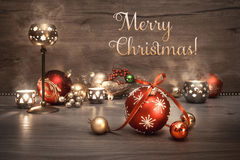 Vintage Christmas background with candles and decorations, text Stock Image