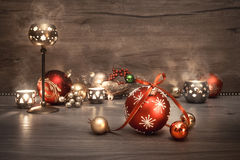 Vintage Christmas background with candles and decorations, text. Vintage Christmas background with candles and Christmas baubles, text space. This image is toned Royalty Free Stock Images