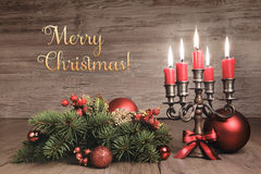 Vintage Christmas background with candles and decorations, text Stock Photos