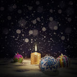 Vintage Christmas background with Christmas balls and burning ca Stock Photos