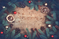 Vintage Christmas background. Fir branches Toys Spices arranged Royalty Free Stock Photography