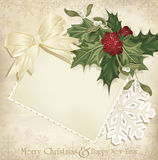 vintage christmas background with holly and ribbon Royalty Free Stock Photos