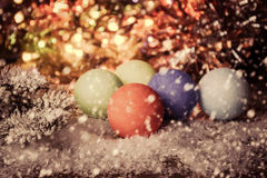 Vintage christmas background with multi color Christmas decorations on snow. Stock Photos