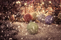 Vintage Christmas background with multi color Christmas decorations on snow. Royalty Free Stock Images