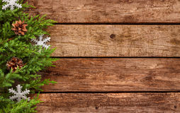 Vintage christmas background - old wood and pine branch. Vintage christmas background - old planked wood board with pine tree branch and decoration Stock Photography