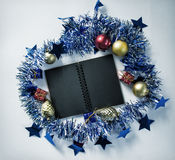 Vintage Christmas background photo. Black spiral notebook open. Royalty Free Stock Image