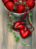 Vintage christmas background with red baubles and hearts Royalty Free Stock Images