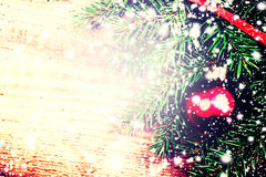 Vintage Christmas Background with Tree Branch on wooden backgrou Royalty Free Stock Images