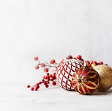 Vintage Christmas balls and holly berry twigs Stock Photography