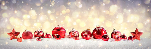 Vintage Christmas Baubles On Snow Royalty Free Stock Photos