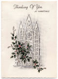Vintage Christmas Card. Vintage early 1900s Christmas card with church windows & colored holly spray Royalty Free Stock Photo