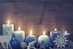 Vintage Christmas Card With Blue Candles, Reindeer, Ball Royalty Free Stock Image