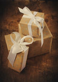 Vintage Christmas Card with Boxes, white ribbons Royalty Free Stock Photography