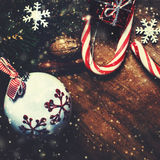 Vintage Christmas Card  with Christmas decoration and snow over Royalty Free Stock Photos