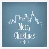 Vintage Christmas card design with cityscape or Royalty Free Stock Image