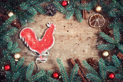Vintage Christmas card. Fire Rooster symbol of the year. Snowfal Stock Photography