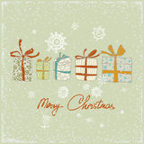 Vintage Christmas card with gifts and snowflakes. Vector illustration. Greeting card Stock Photos