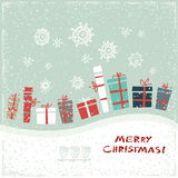 Vintage Christmas card with gifts and snowflakes. Vector illustration. Greeting card Royalty Free Stock Images