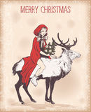 Vintage Christmas card with girl in a red cloak on deer Stock Photo