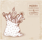 Vintage Christmas card with sack full of gifts. Stock Photography