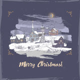 Vintage Christmas card with village color sketch on blue background. Royalty Free Stock Photo